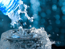 Bottle with creative splashing water Stock Image
