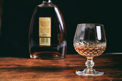 Bottle and crystal glass of cognac Royalty Free Stock Images
