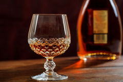 Bottle and crystal glass of cognac Royalty Free Stock Photography
