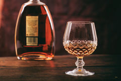 Bottle and crystal glass of cognac Royalty Free Stock Photos