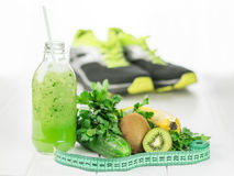 Bottle cucumber smoothie with kiwi and parsley. Royalty Free Stock Photography