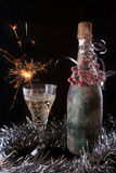 Bottle decorating berries with glass and sparklers Stock Photo