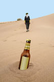 Bottle in desert Stock Images