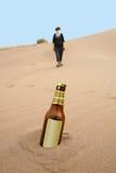 Bottle in desert. Bottle in sand around thirsty girl in desert Stock Images