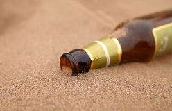 Bottle in desert Royalty Free Stock Images