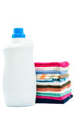 Bottle of detergent and a stack of laundry. Stock Images