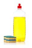 Bottle of dish washing and sponges Stock Images