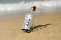 Bottle with dollar sign Stock Images