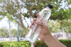 bottle of drinking water in the hand of men after exercise royalty free stock photos