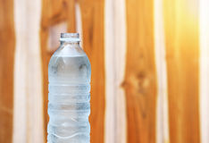 A bottle of Drinking water. On wooden background Stock Photo