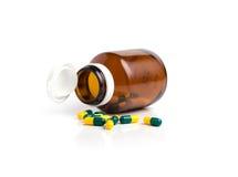 Bottle drug capsules isolated on white background Royalty Free Stock Photos