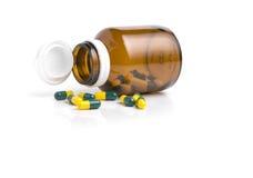 Bottle drug capsules  on white background Royalty Free Stock Photo