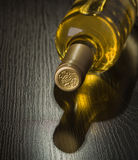 Bottle of dry white wine. On a dark background Royalty Free Stock Image