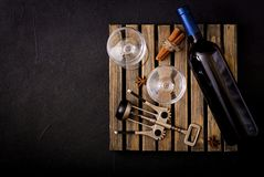 Bottle of dry white wine and a glasses. Stock Images