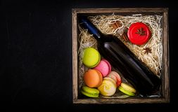 Bottle of dry white wine and a macaroon. Stock Image