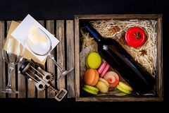 Bottle of dry white wine and a macaroon Royalty Free Stock Photos