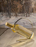 Bottle of dry white wine. On a wooden background Royalty Free Stock Photos