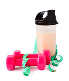 Bottle,dumbbells,meter on the white background Royalty Free Stock Photo