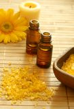 Bottle of essence oil, bath salt and flower Stock Photos