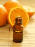 bottle of essence oil and fresh oranges Royalty Free Stock Image