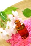 Bottle of essential oil,  bath salt and flower Stock Image