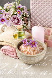 Bottle of essential oil, bowl with sea salt and scented candle. Spa time Royalty Free Stock Image