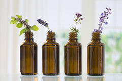 Bottle of essential oil. Brown bottle  with aromatic herbs for essential oil