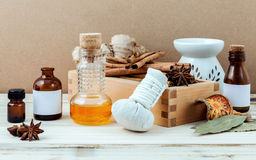 Bottle of essential oil with cinnamon stick ,star anise ,bay lea Stock Image