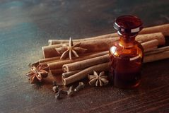 Bottle of essential oil Cinnamon royalty free stock photo