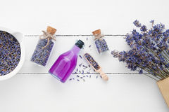 Bottle of essential oil, mortar, lavender flowers royalty free stock photos