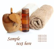 Bottle of essential oil and towels. Royalty Free Stock Images