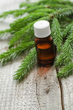 Bottle of essential spruce (fir) oil Royalty Free Stock Photos