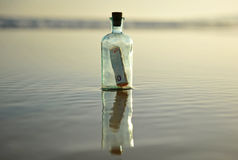 Bottle with 50 euro inside. Bottle found on the beach with a fifty euro bill inside Royalty Free Stock Images