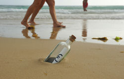 Bottle with euro sign on the sand of the beach, money concept Royalty Free Stock Image