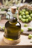 Bottle of extra virgin olive oil. On table Stock Images