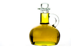 Bottle of extra virgin olive oil isolated. Transparent bottle of extra virgin olive oil isolated on white background Royalty Free Stock Image