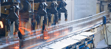 Bottle factory, process of making glass bottles. Bottle factory, process of making transparent glass bottles Stock Photography