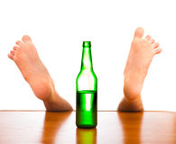 Bottle and Fallen Man Royalty Free Stock Photo
