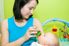 Bottle feeding. Mother feeds her newborn with bottle. Mother has eye contact with her baby. Horizontal shot stock images