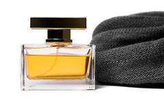 Bottle of female perfume and grey wool scarf Royalty Free Stock Photos
