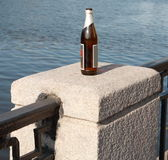 Bottle on fence Royalty Free Stock Photo