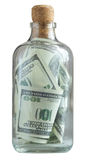 Bottle filled with dollars Stock Images