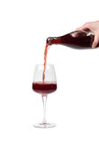 Bottle filling a glass of wine Royalty Free Stock Photo