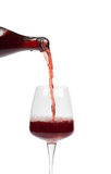 Bottle filling a glass of wine Stock Images