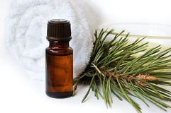 Bottle of fir tree oil and towel Royalty Free Stock Photo