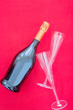 Bottle of fizz and glasses Stock Photography