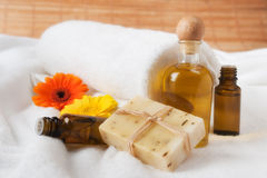 Bottle of Flower Essence, Oil and Raw Soap Royalty Free Stock Photo