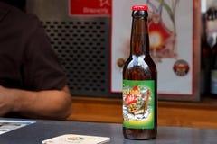 BRUSSELS, BELGIUM - SEPTEMBER 07, 2014: Bottle of the Forestinne Nordika beer brewed by Brasserie Caracole. Bottle of the Forestinne Nordika beer brewed by Stock Image