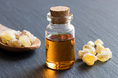 A bottle of frankincense essential oil with frankincense resin Royalty Free Stock Photo