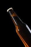 Bottle of fresh beer with drops,isolated on black Royalty Free Stock Photo